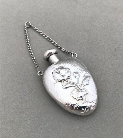 a beautiful art nouveau silver pendant scent bottle