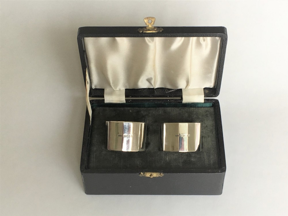 a handsome pair of boxed art deco silver napkin rings