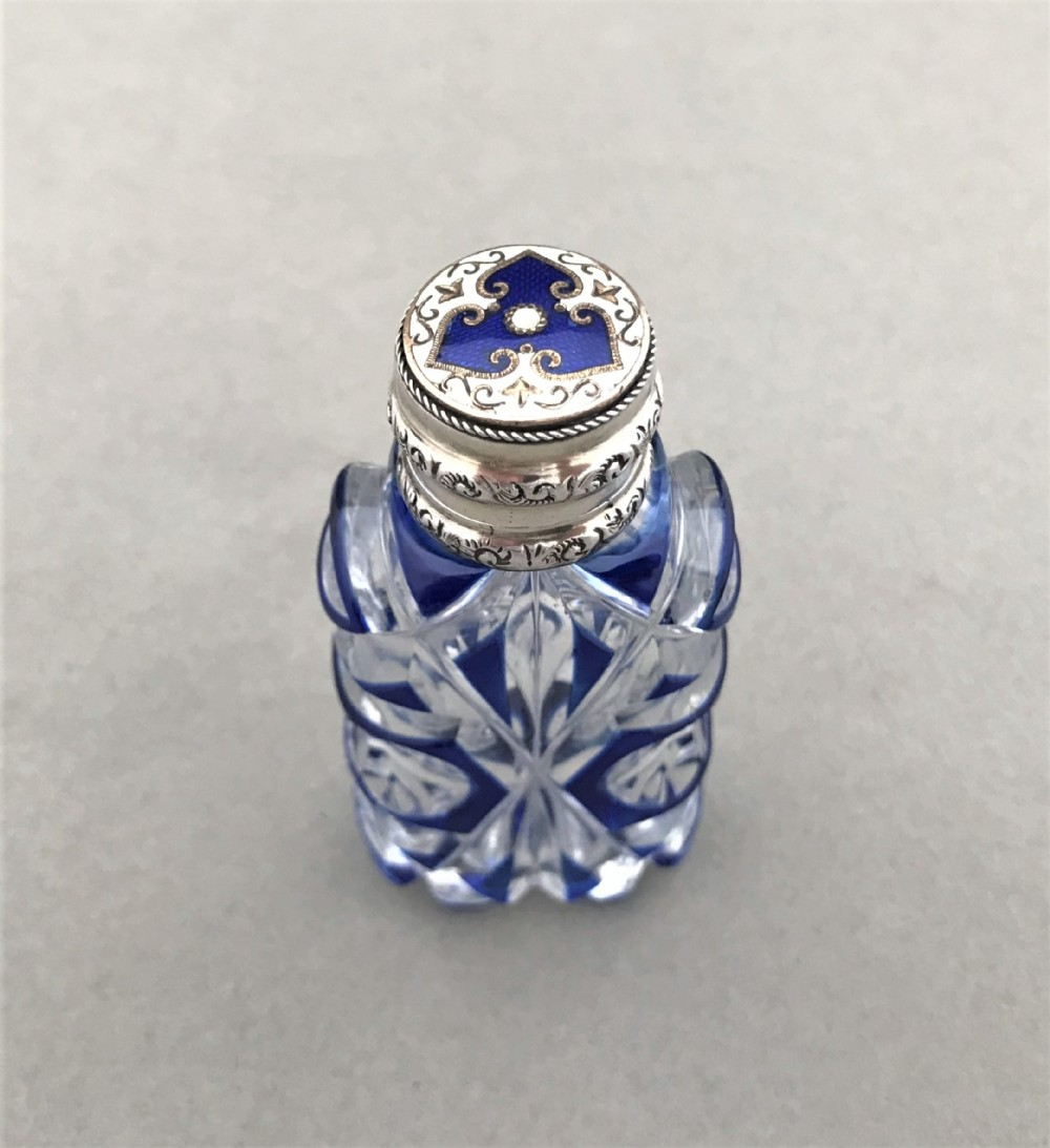 a superb victorian silver enamel mounted scent bottle