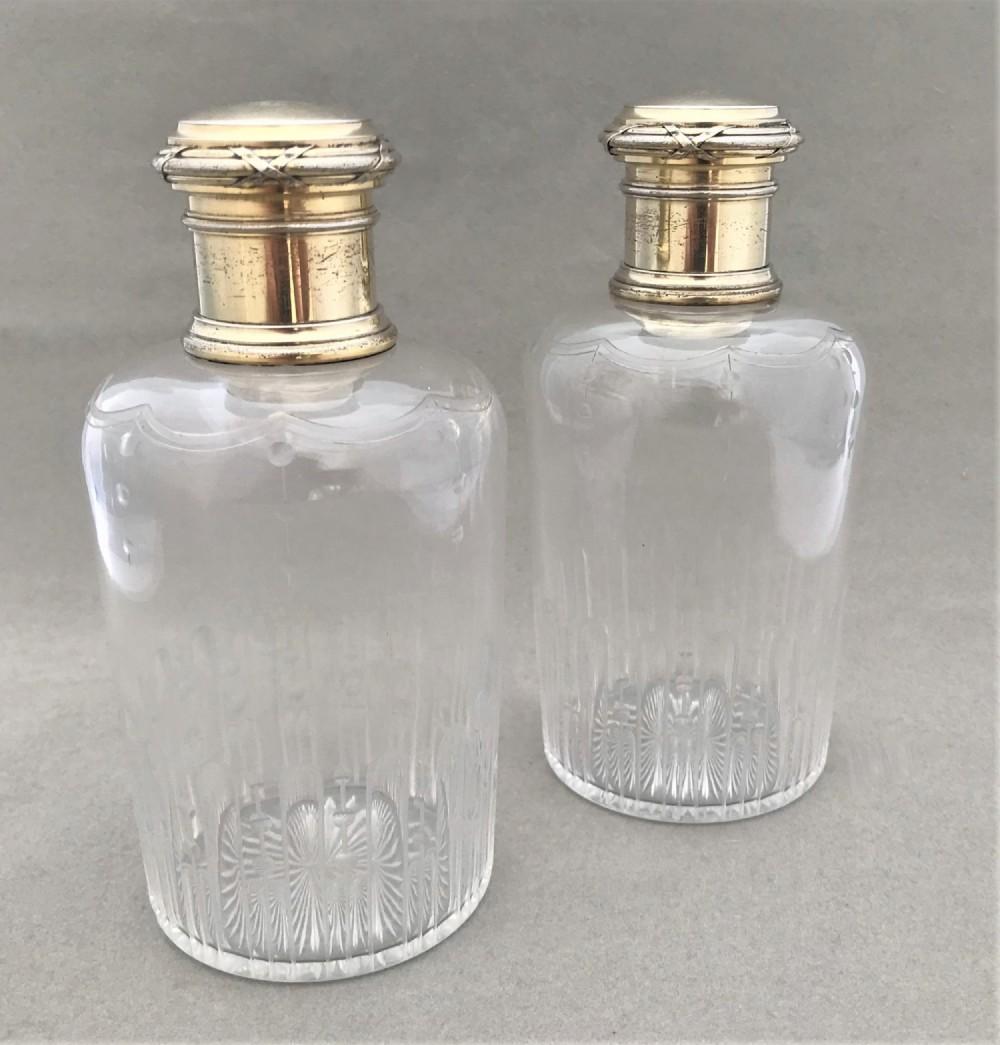 a stunning pair of parisian silver gilt cologne bottles