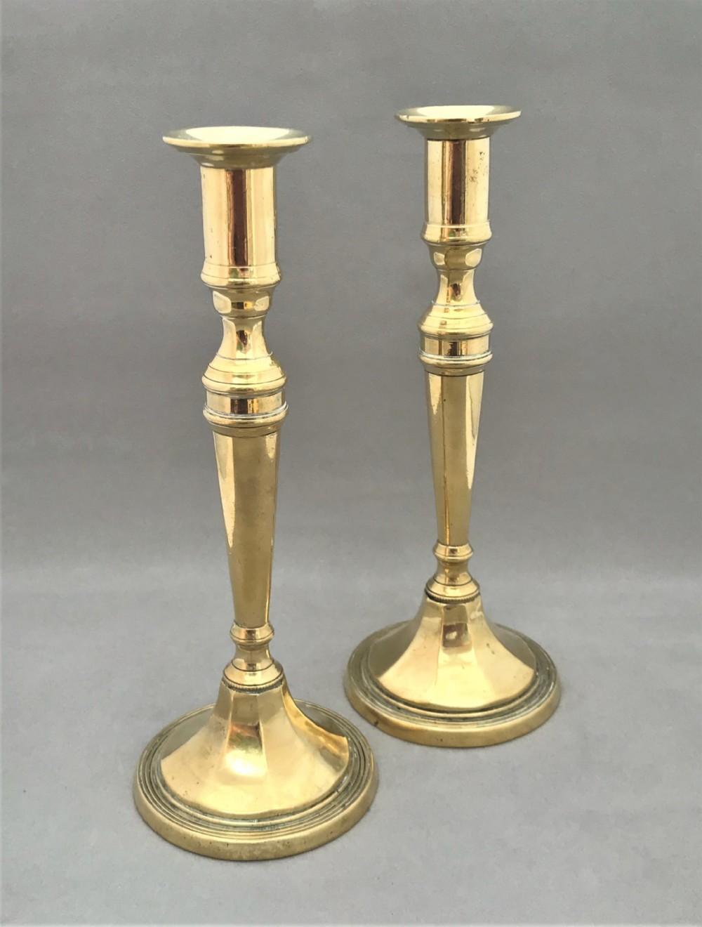 a fine pair of victorian brass candlesticks
