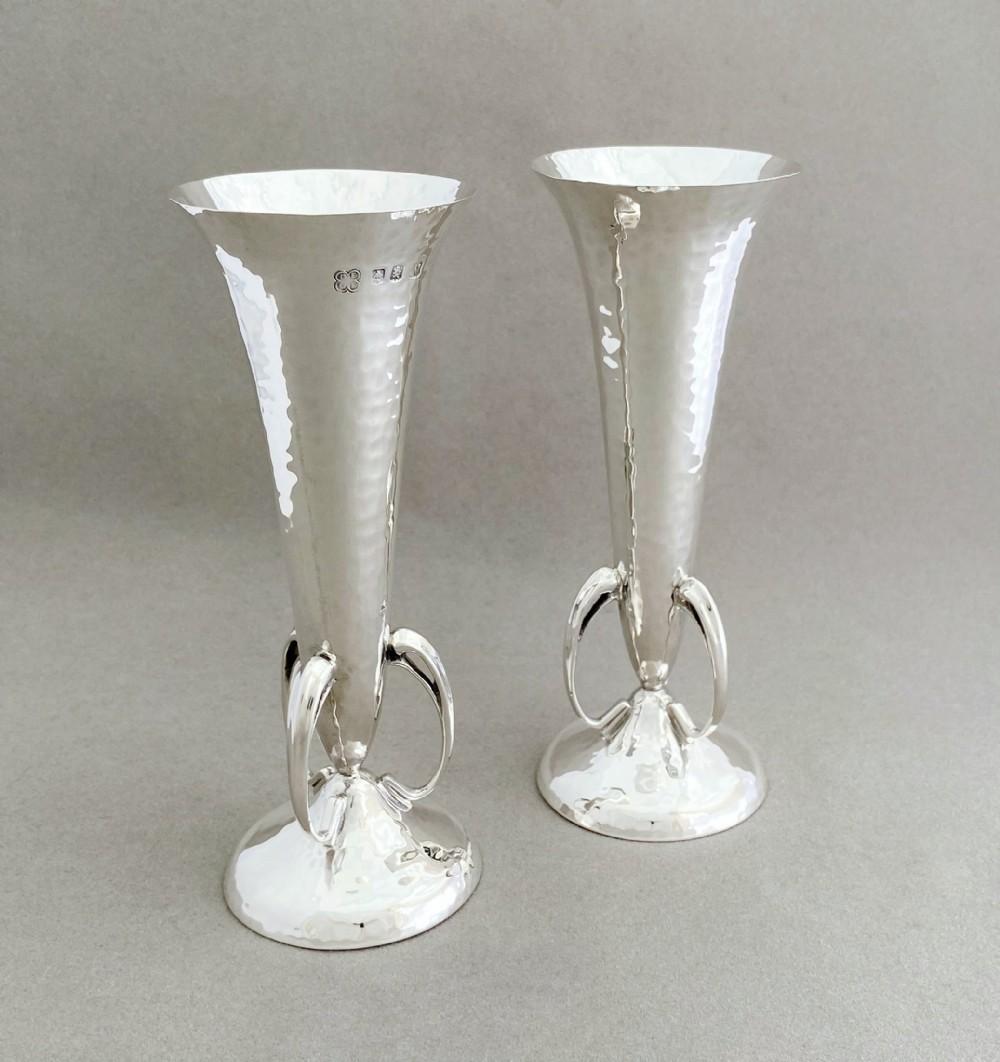 a superb pair of scottish arts crafts silver stem vases