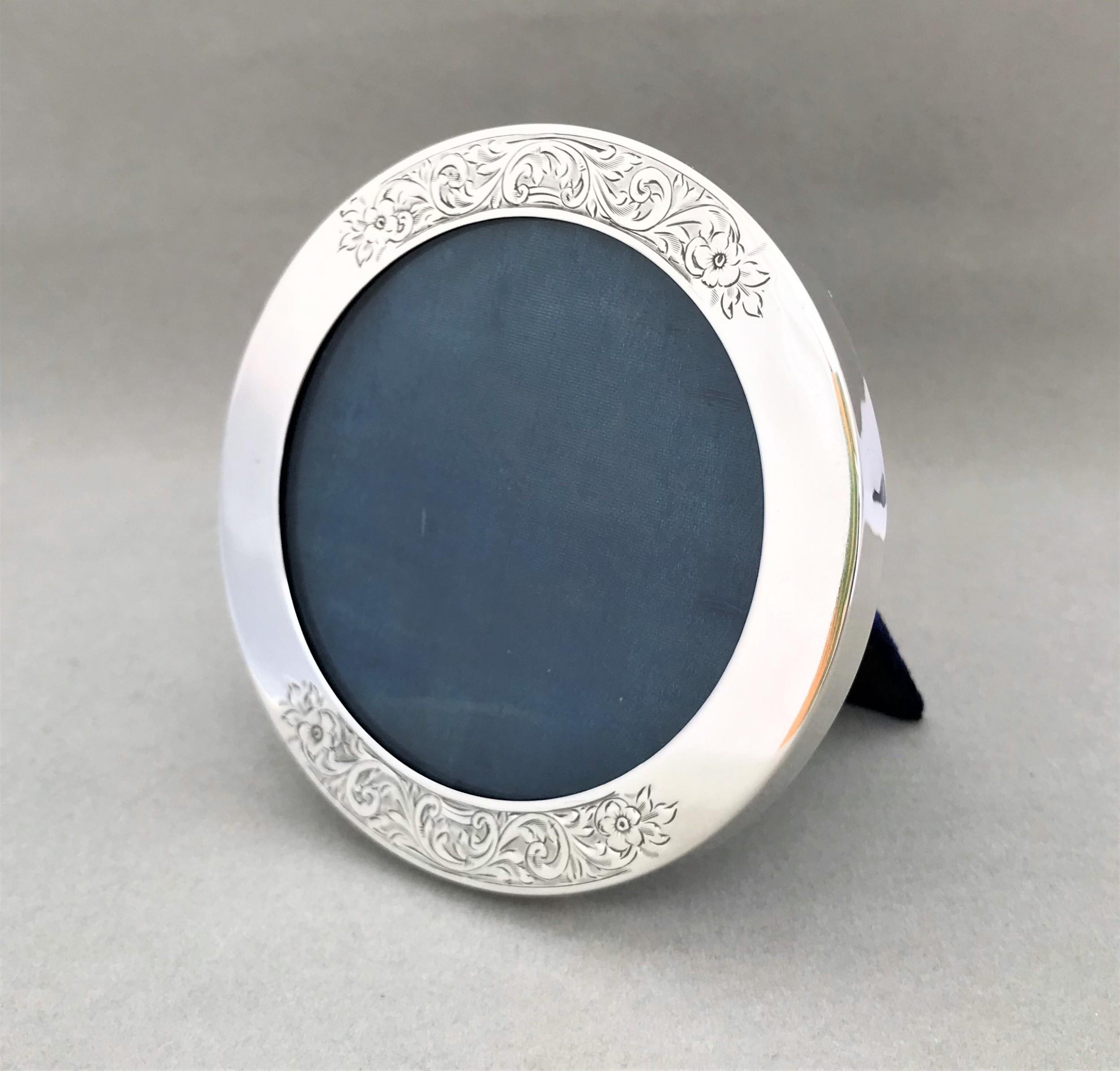 a stylish circular silver photo frame