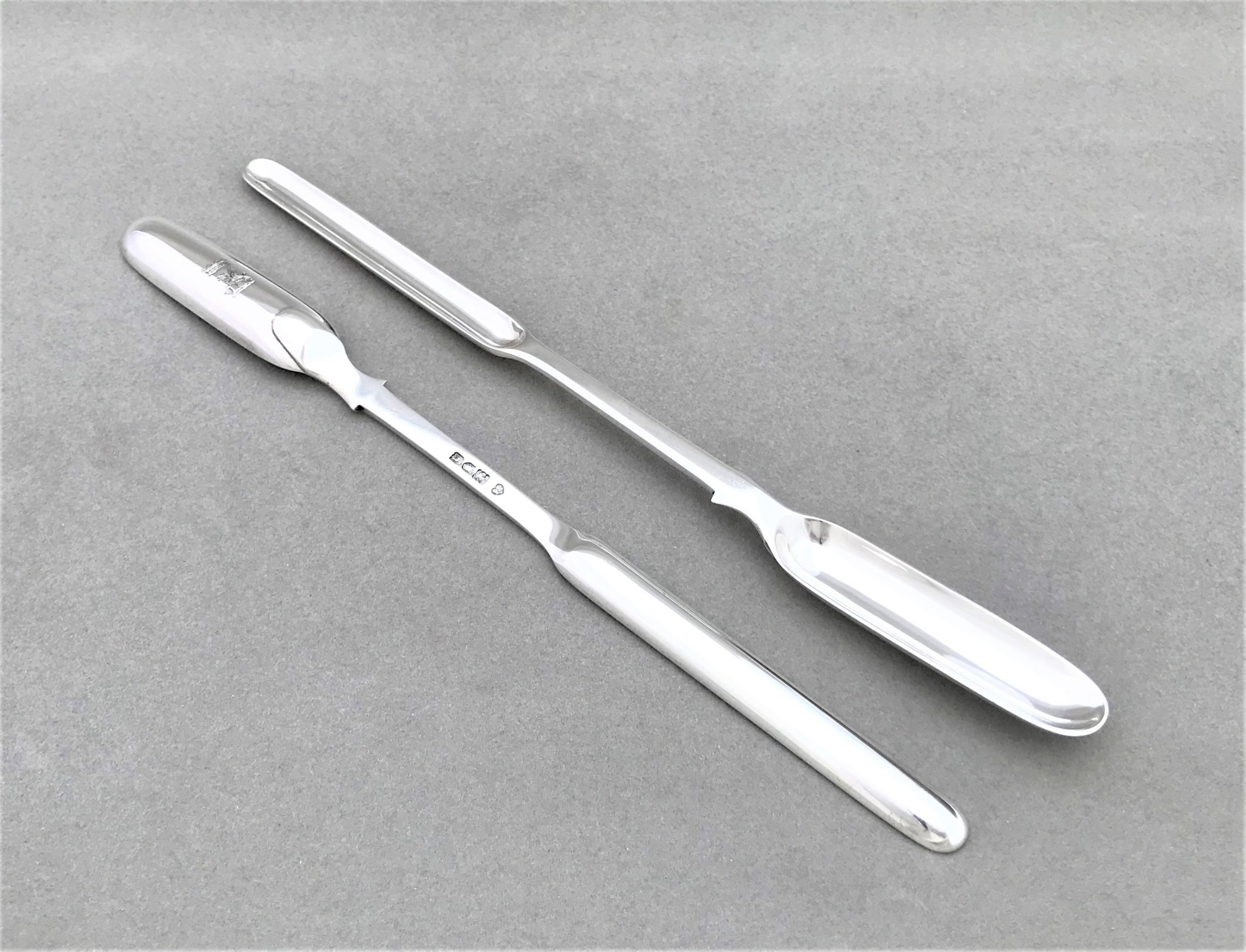 a rare pair of quality edwardian silver marrow scoops