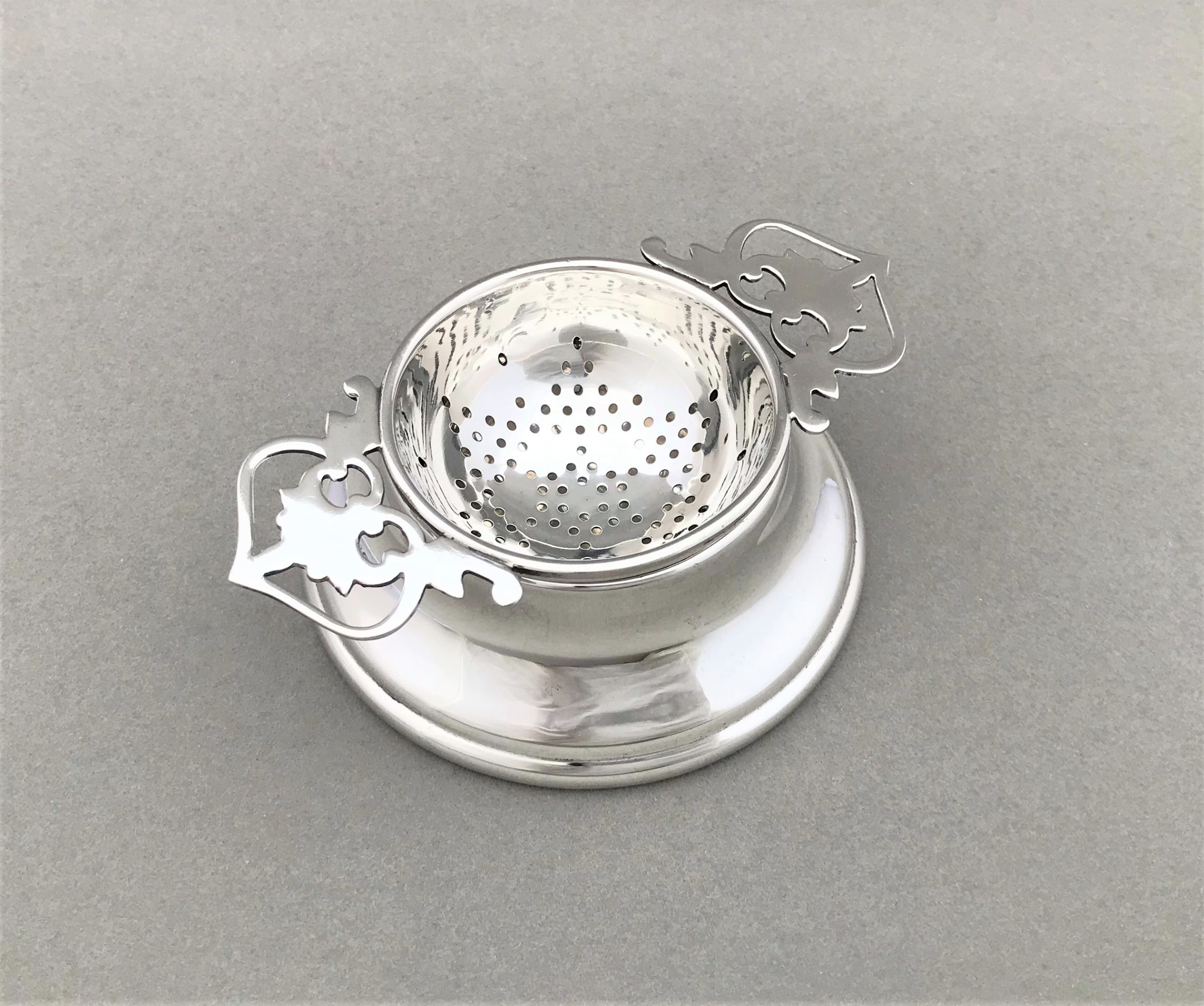 a lovely george vi silver tea strainer cup