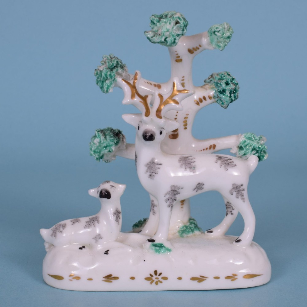 a good quality 19th century english porcelain miniature group of stag doe