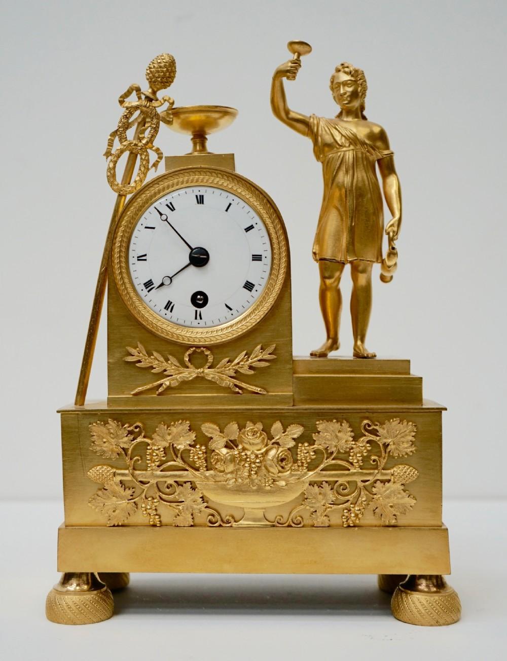 french ormolu wine related mantel clock