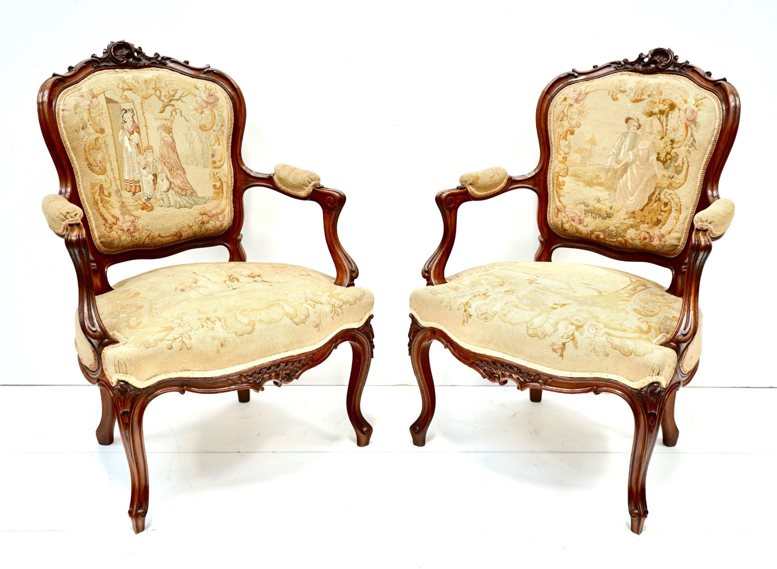 pair of french walnut arm chairs