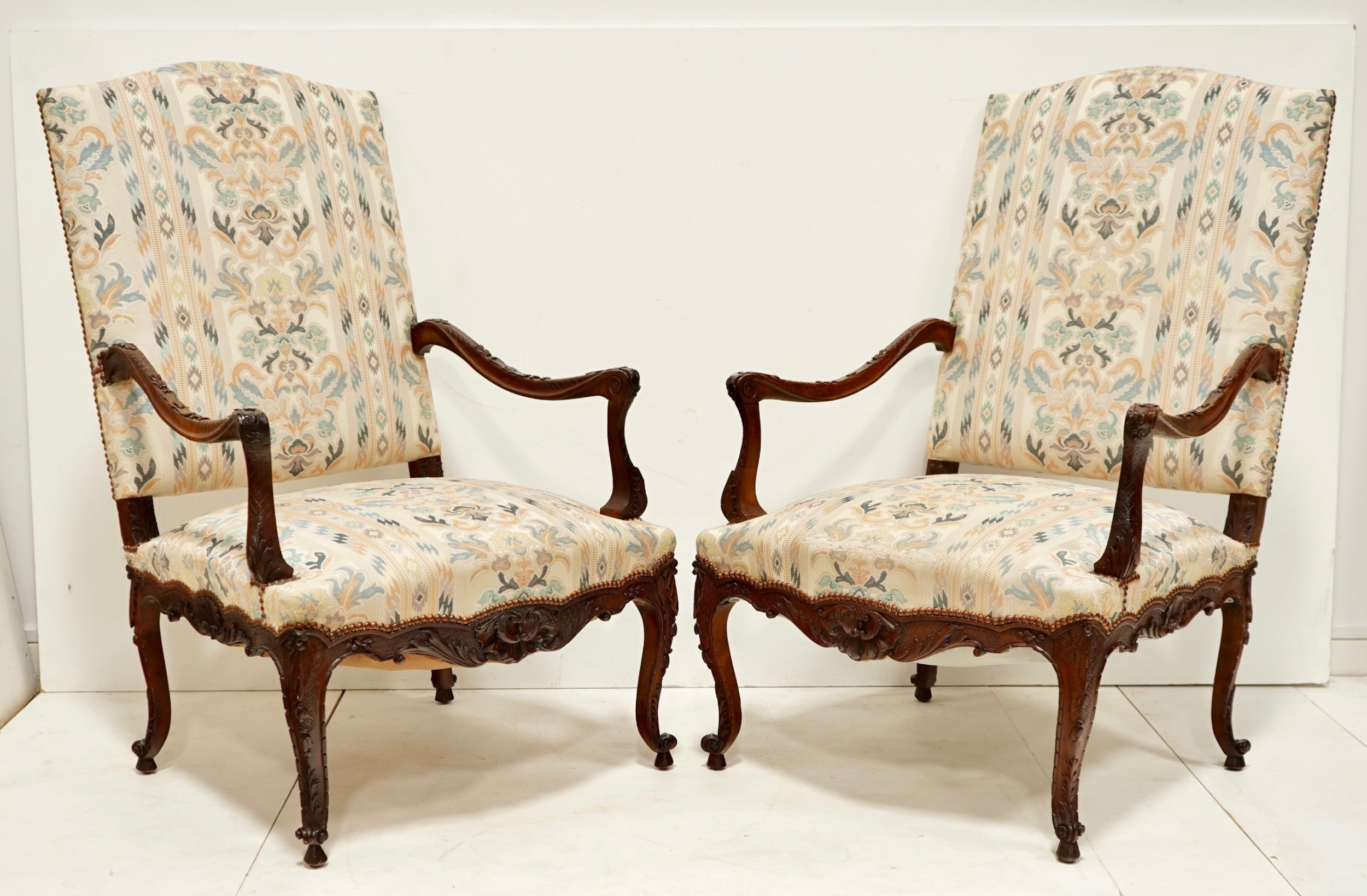 pair of large french walnut arm chairs