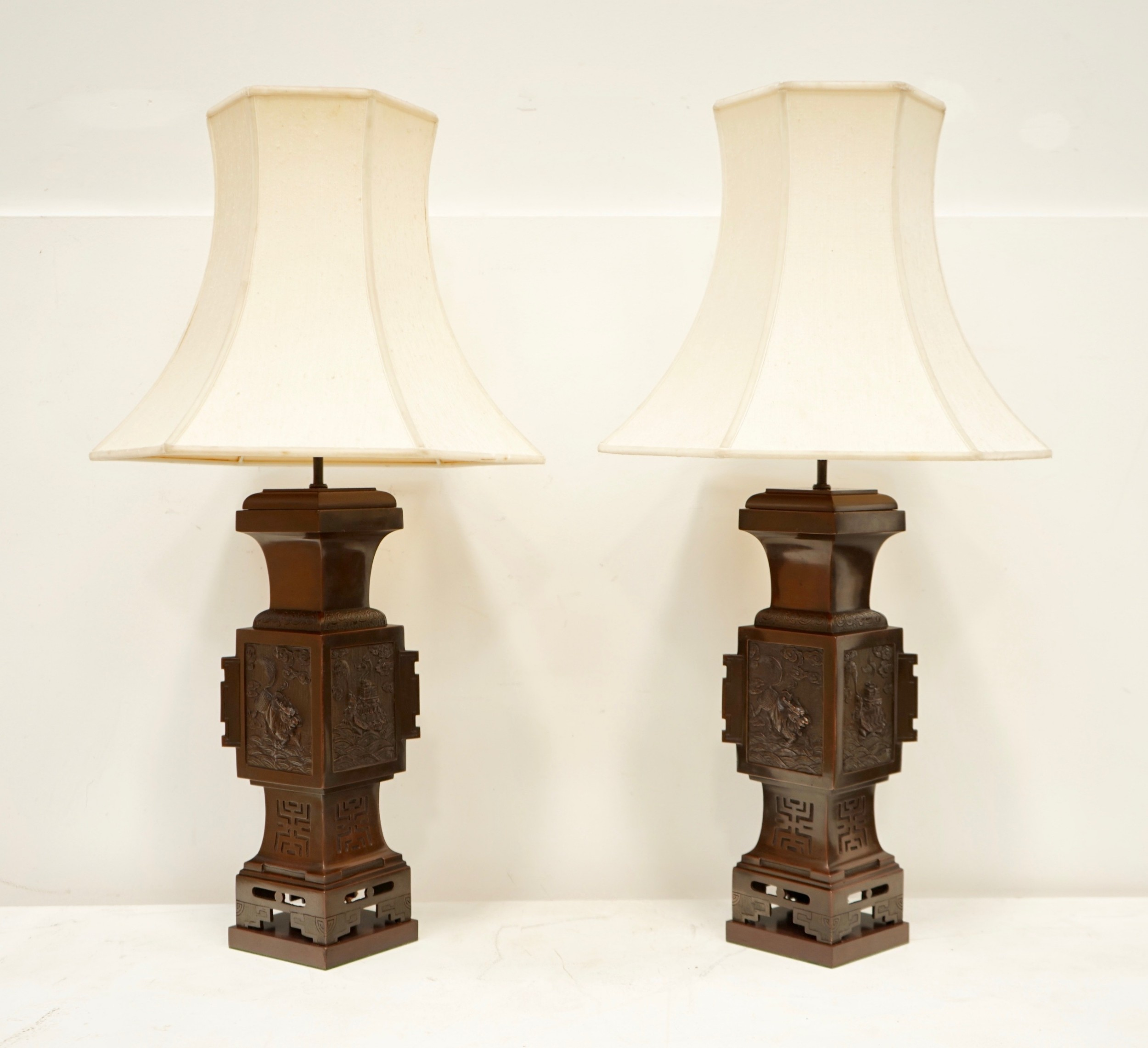 a pair of oriental bronze urn lamps