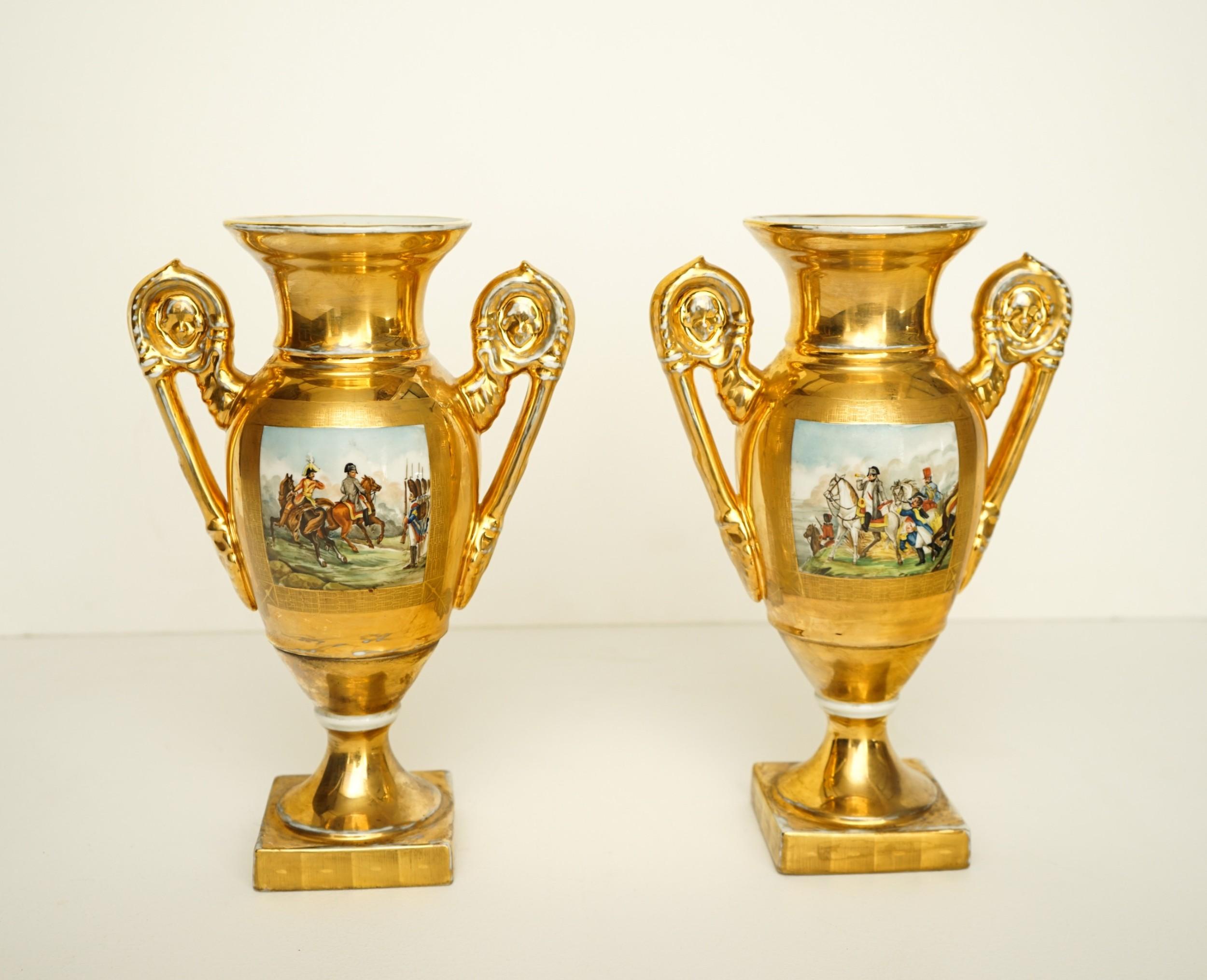 pair of paris porcelain vases depicting napoleon on a gold ground