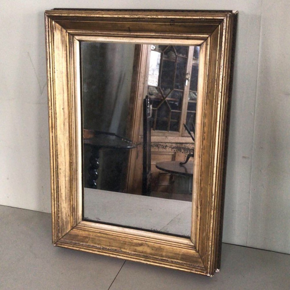 a handsome19thc heavy carved and gilded framed mirror