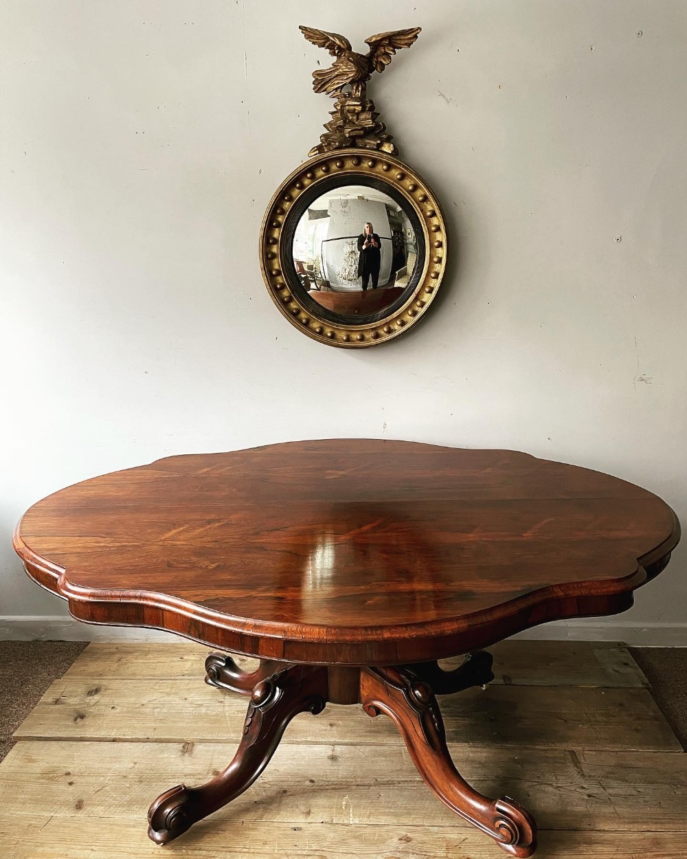 a 19thc shaped rosewood centre table