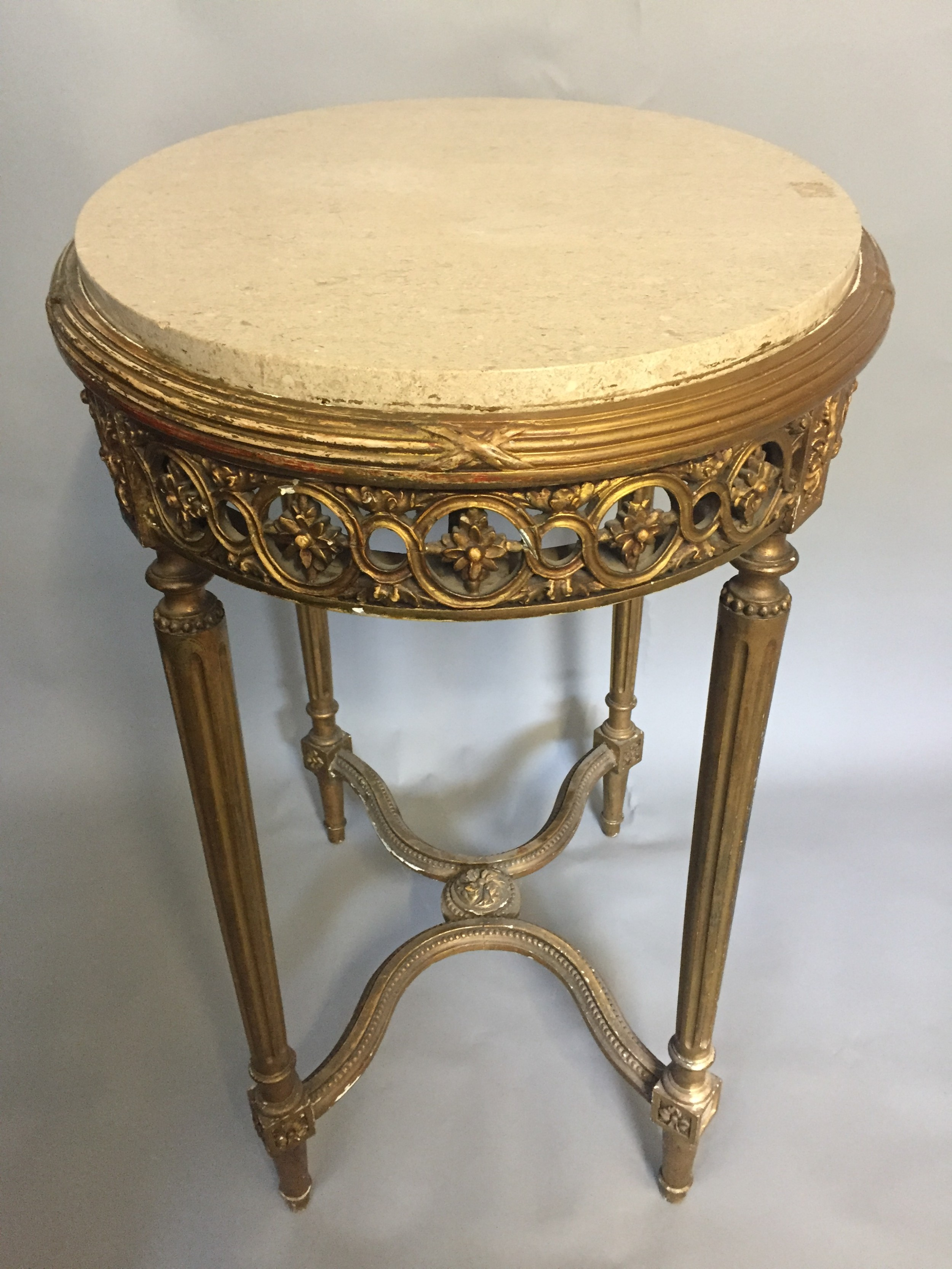 an elegant early 20thc giltwood marble topped lamp table