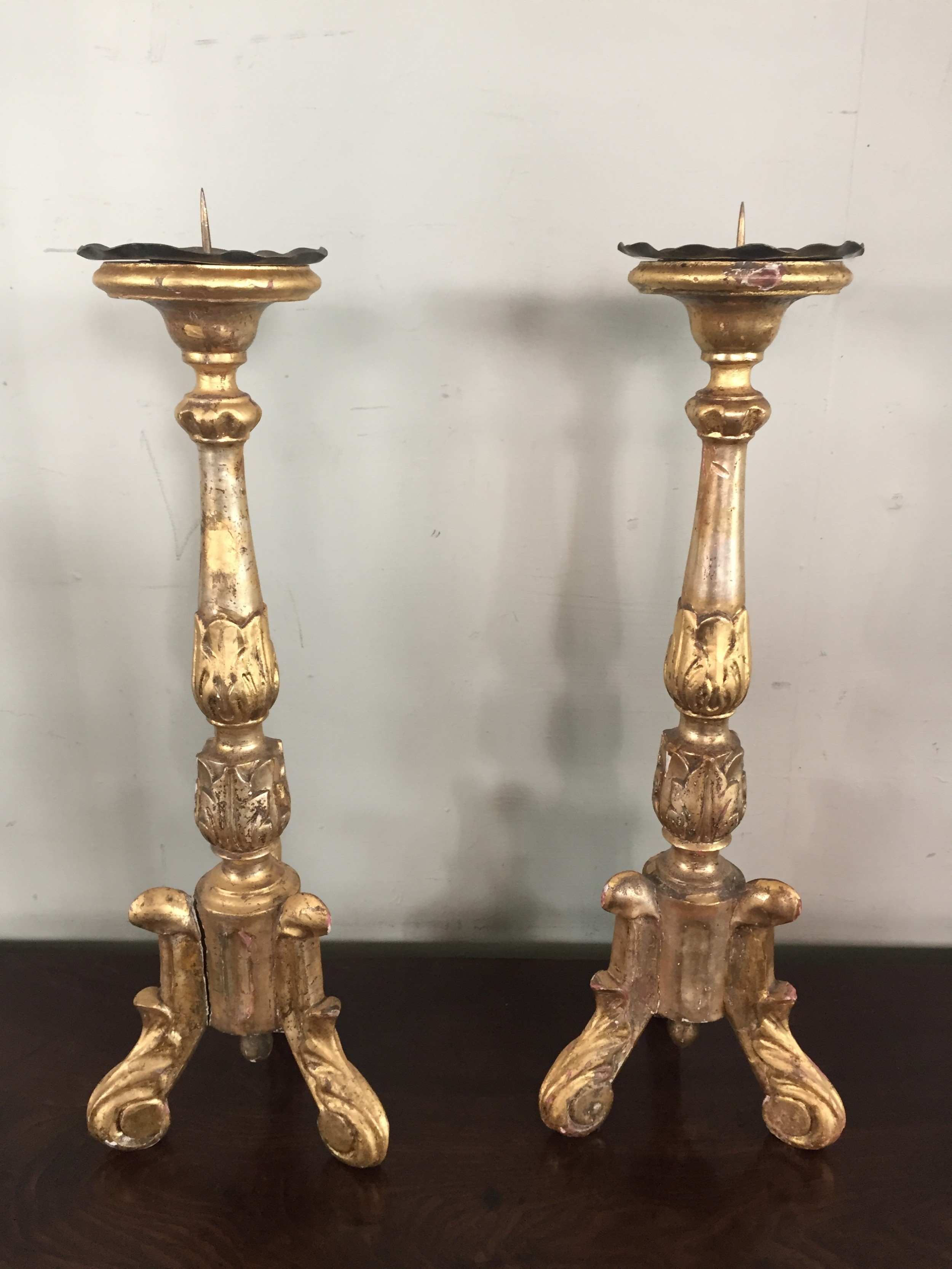 a pair of 18thc continental carved giltwood pricket sticks