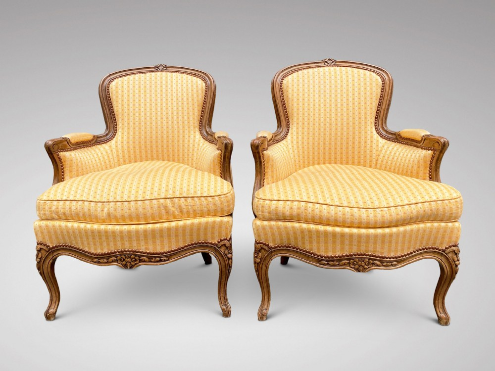 pair of 19c french walnut bergere armchairs