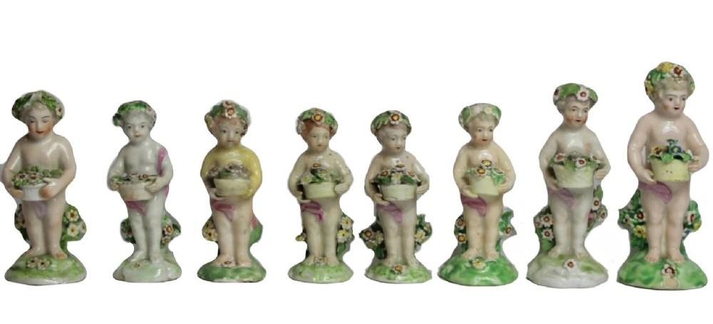 a set of 7 derby porcelain figures