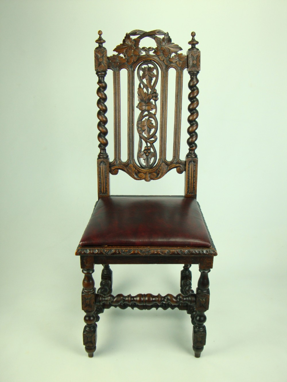antique victorian gothic oak chair with leather seat