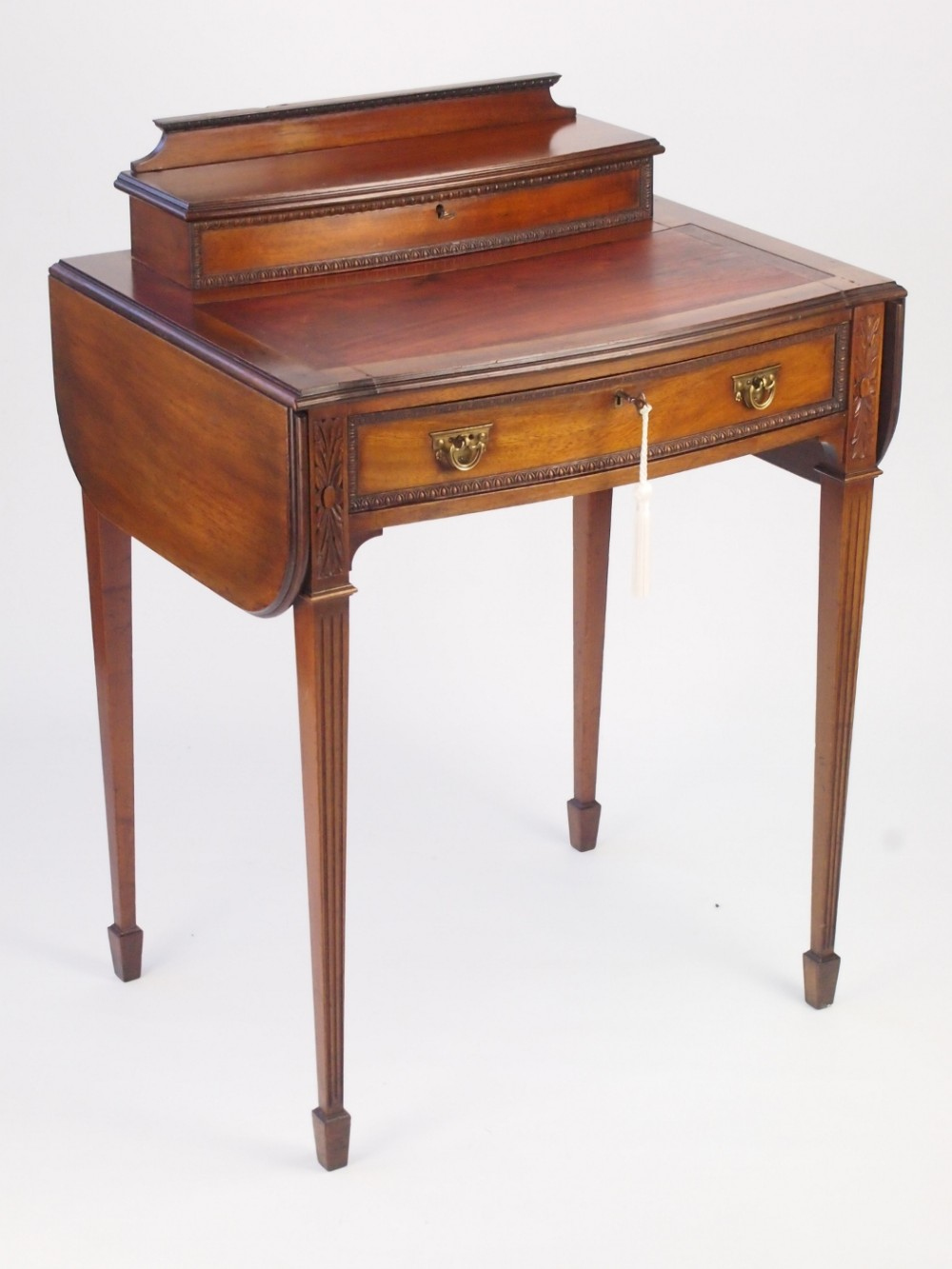 antique davenport writing desk An old english burl walnut davenport writing desk with inlay, carved supports and a tooled leather top on ringed bun feet circa 1860.
