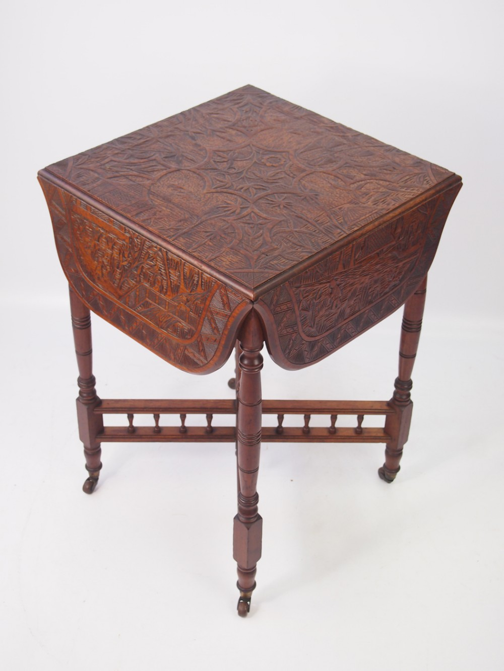 small antique carved walnut drop leaf table