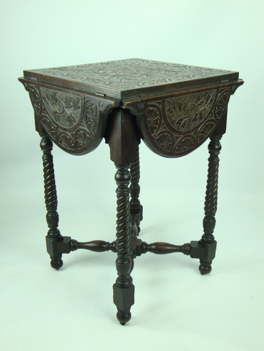 the small antique victorian carved gothic oak table has been added to