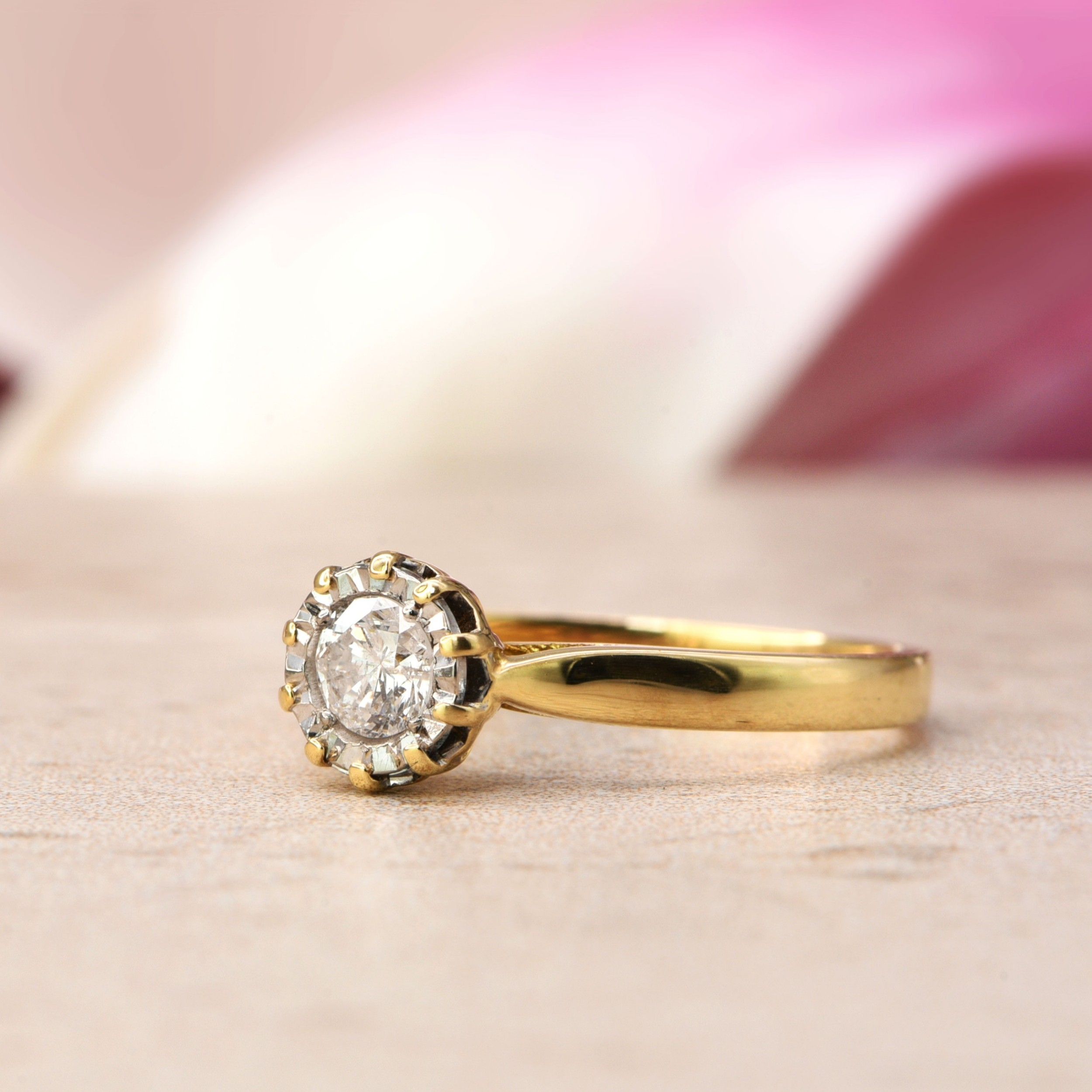the vintage lifted illusion set diamond solitaire ring