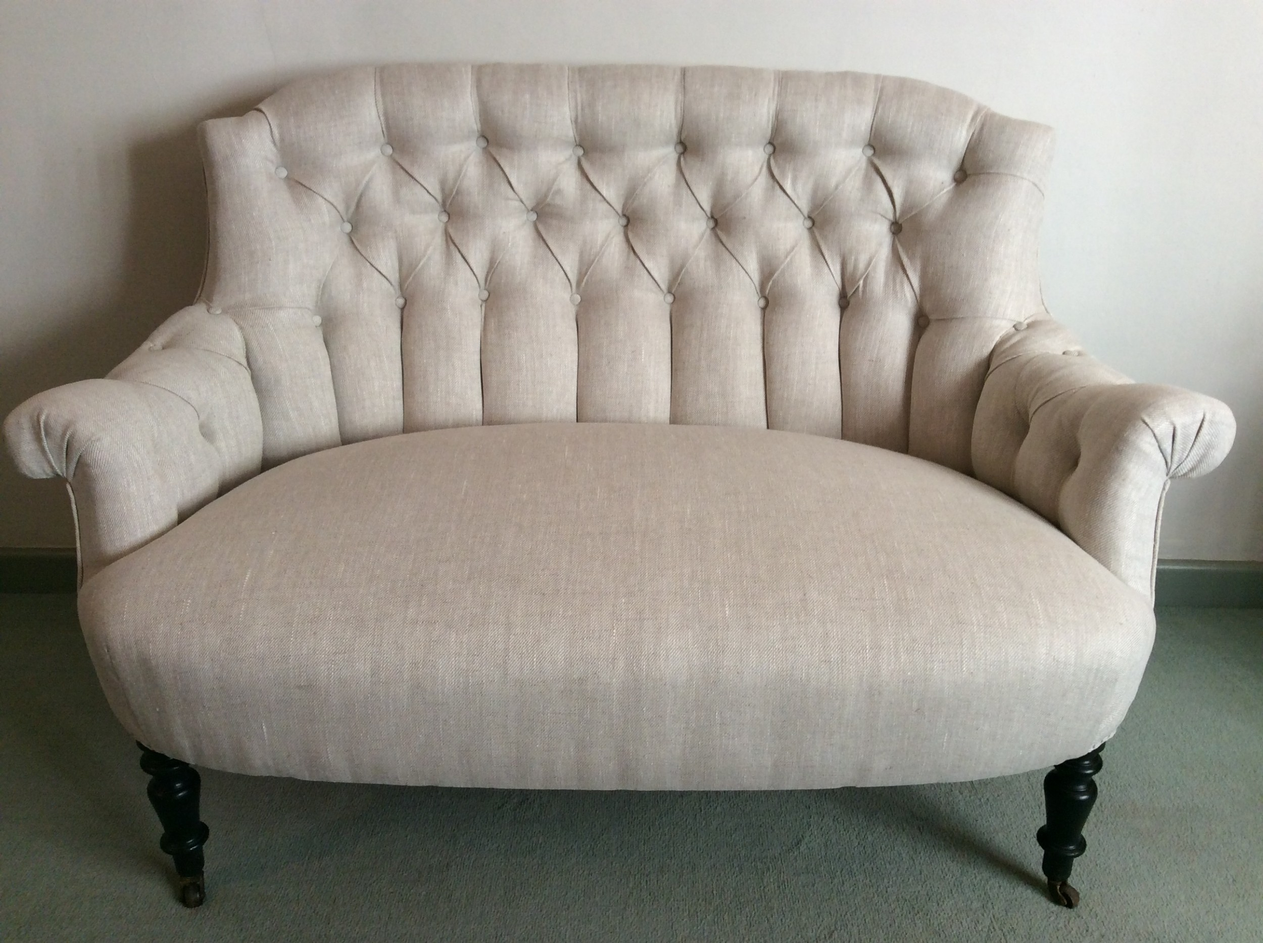 a small buttoned back french sofa