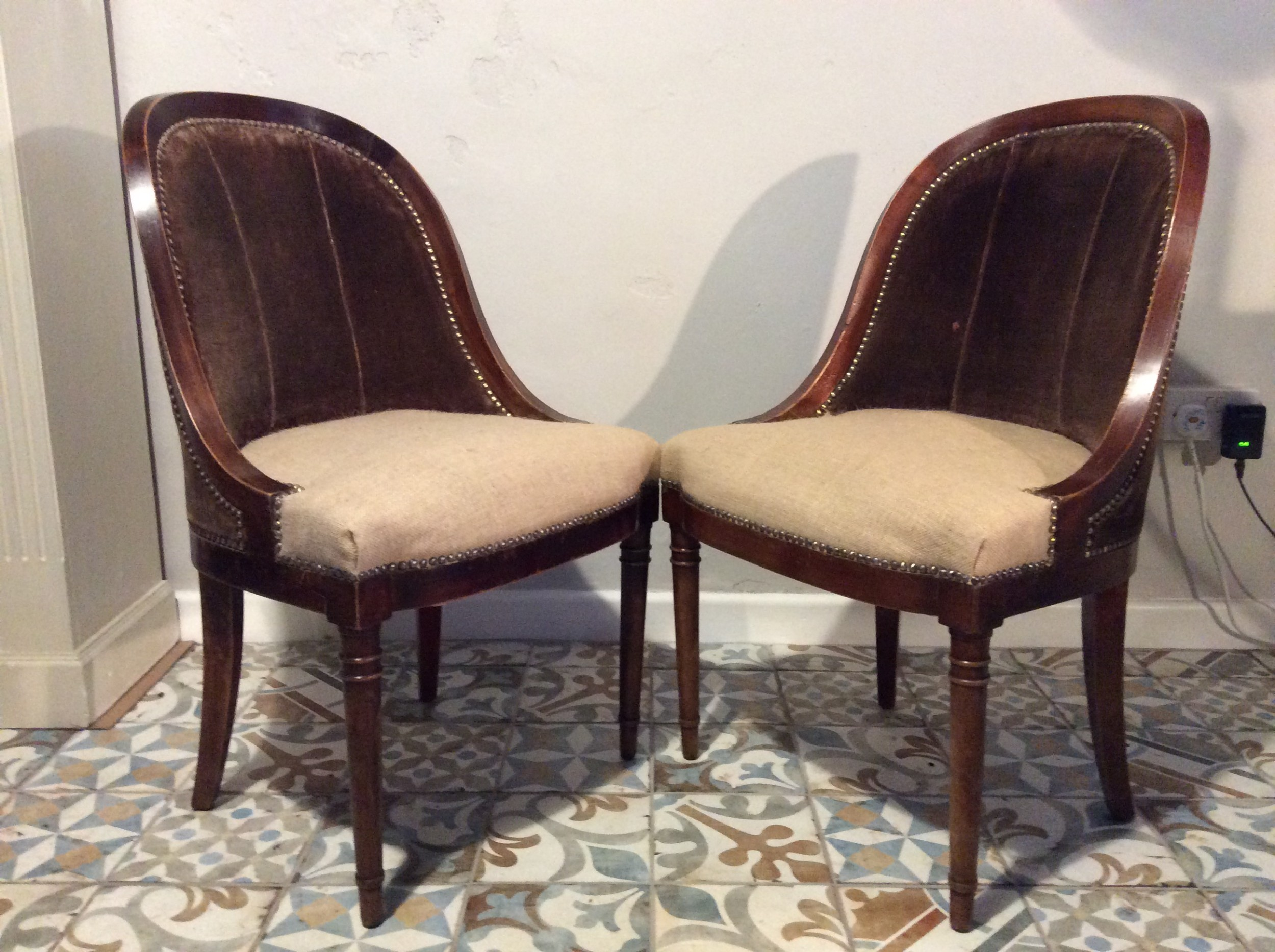 a pair of napoleon hall chairs