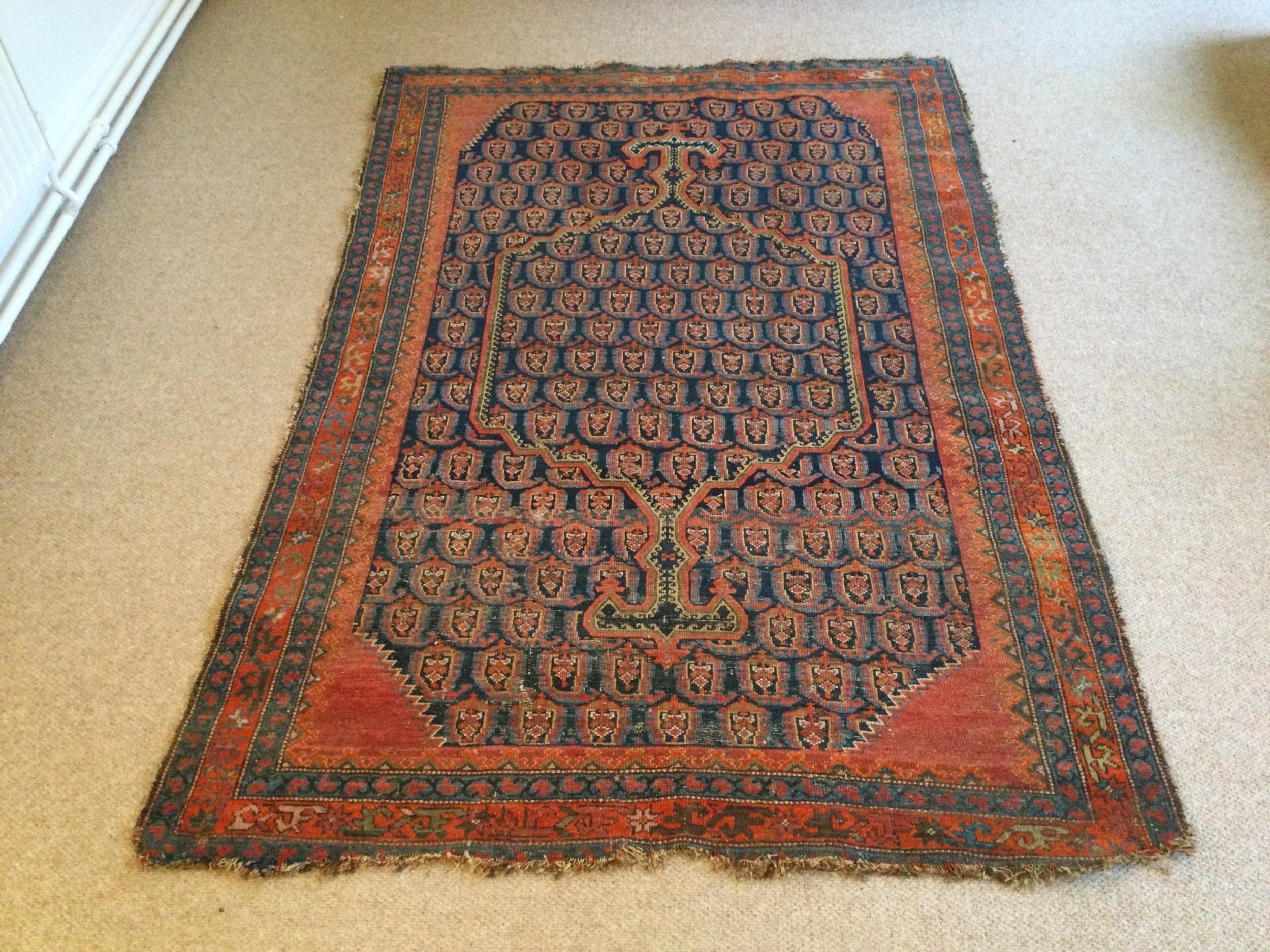 an antique caucasian prayer rug