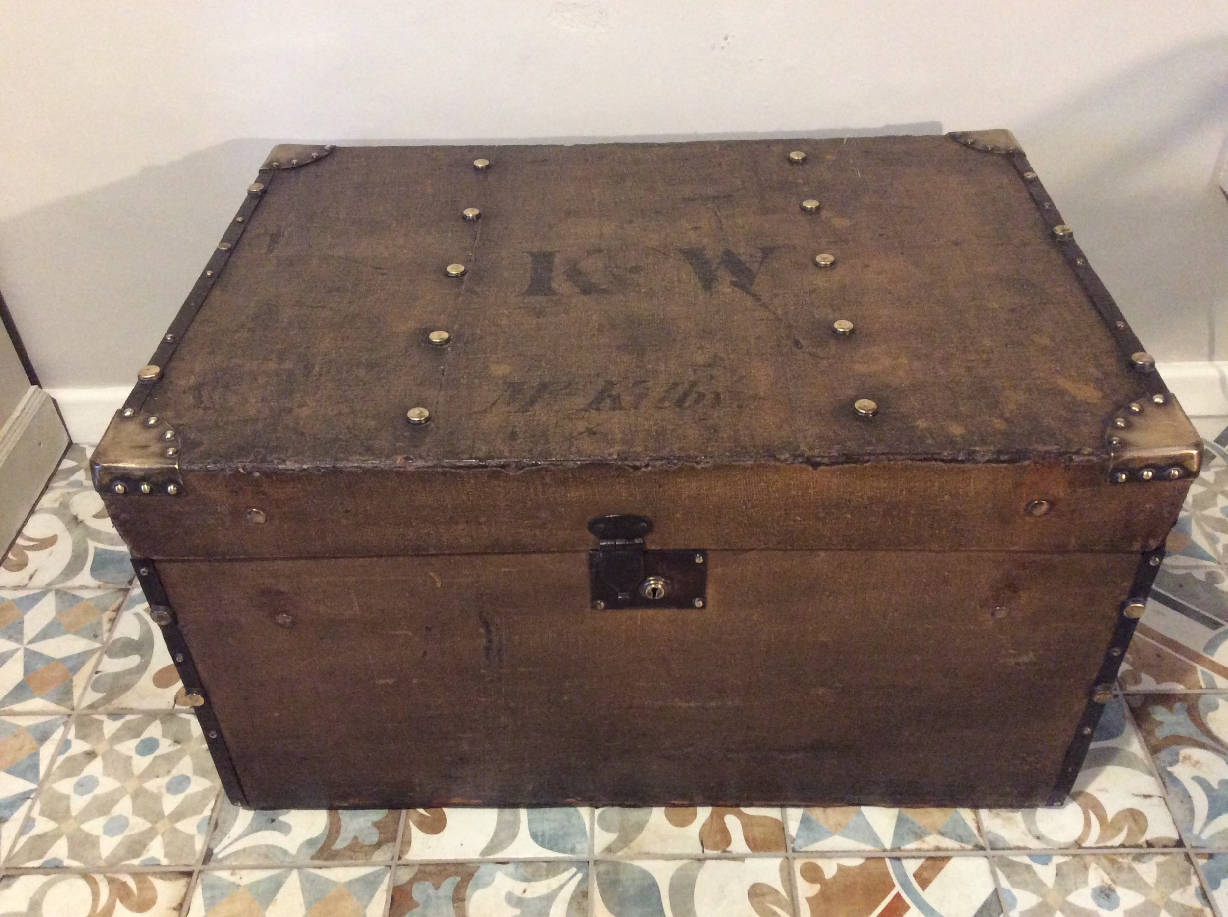 a victorian brass capped trunk