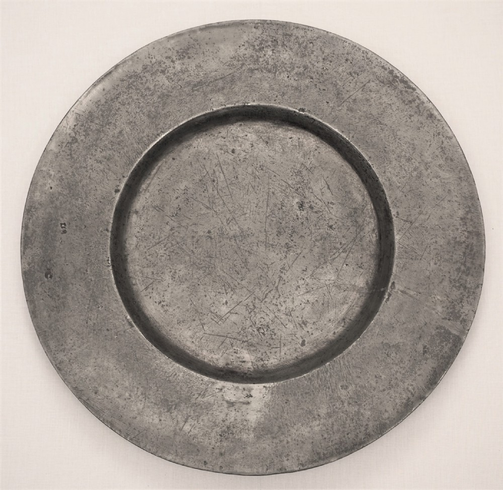 a large charles ii pewter 22in broad rim charger circa 166080