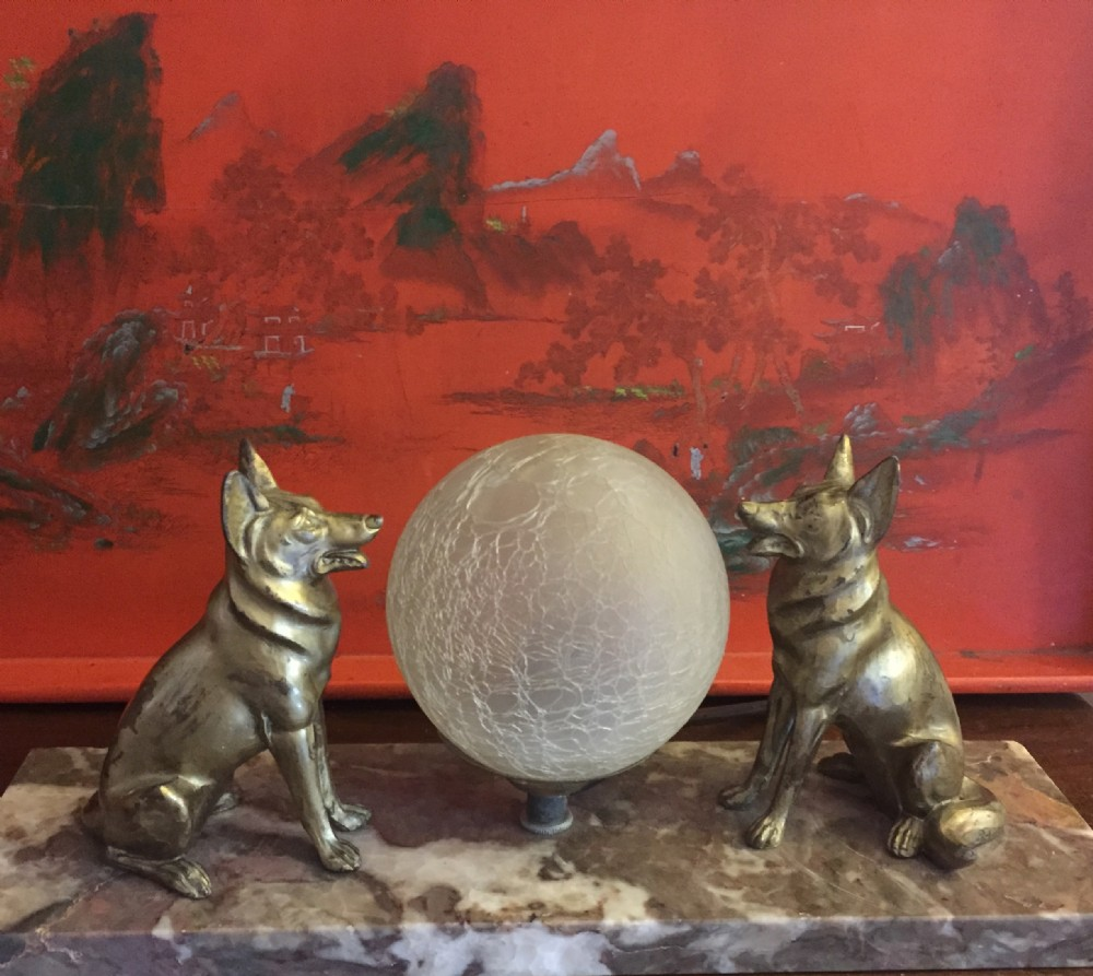 large art deco night light glowing on two alsatians on marble