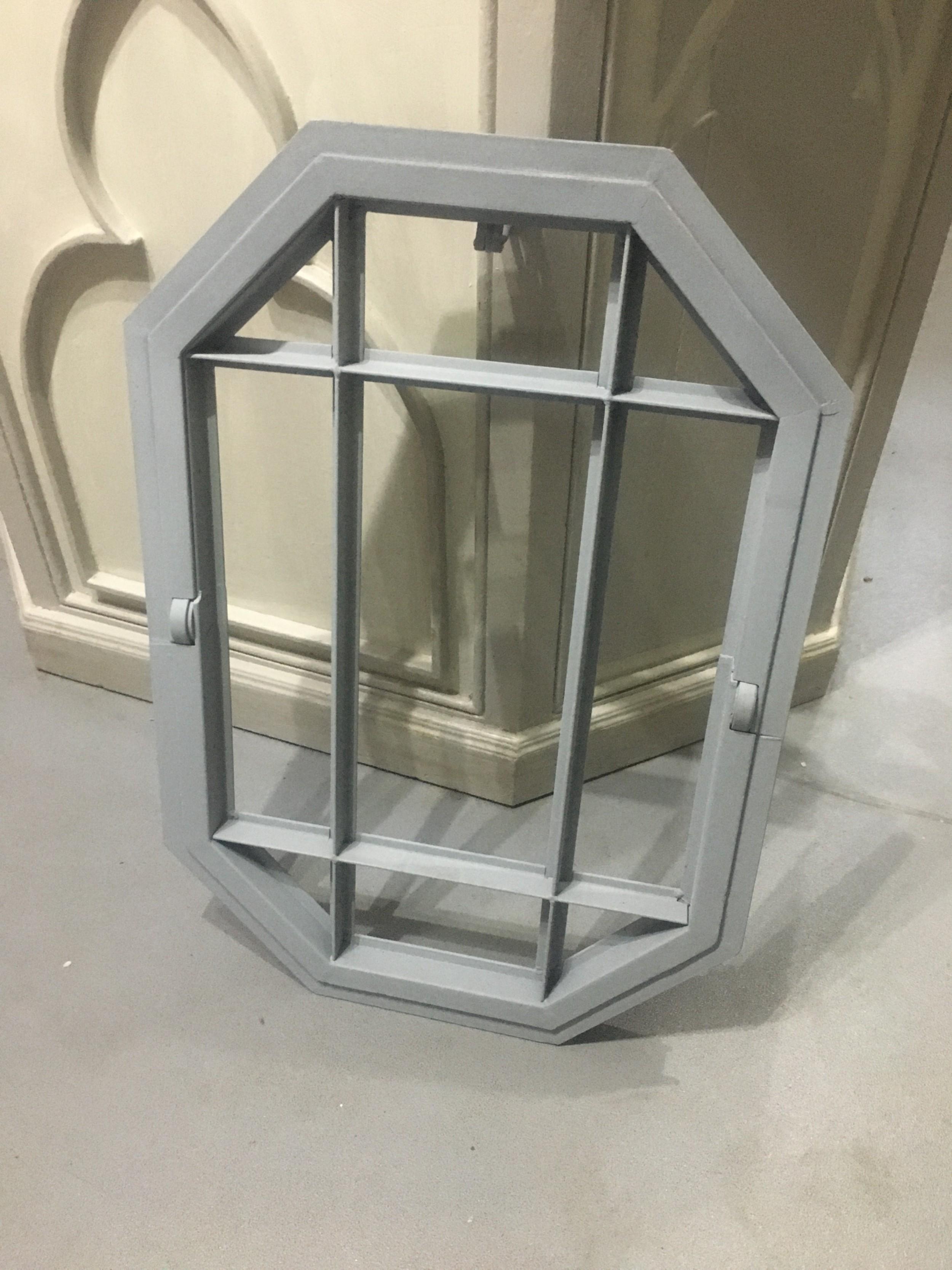 military art deco metal framed centrally tilting window
