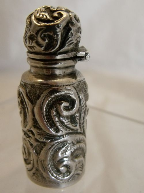 fine silver hallmarked 1898 miniature highly embossed perfume bottle