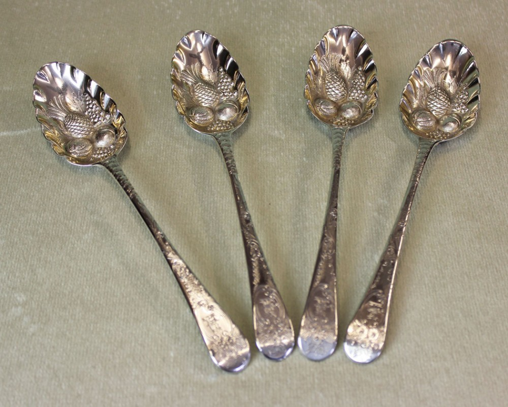 antique set of four silver berry spoons