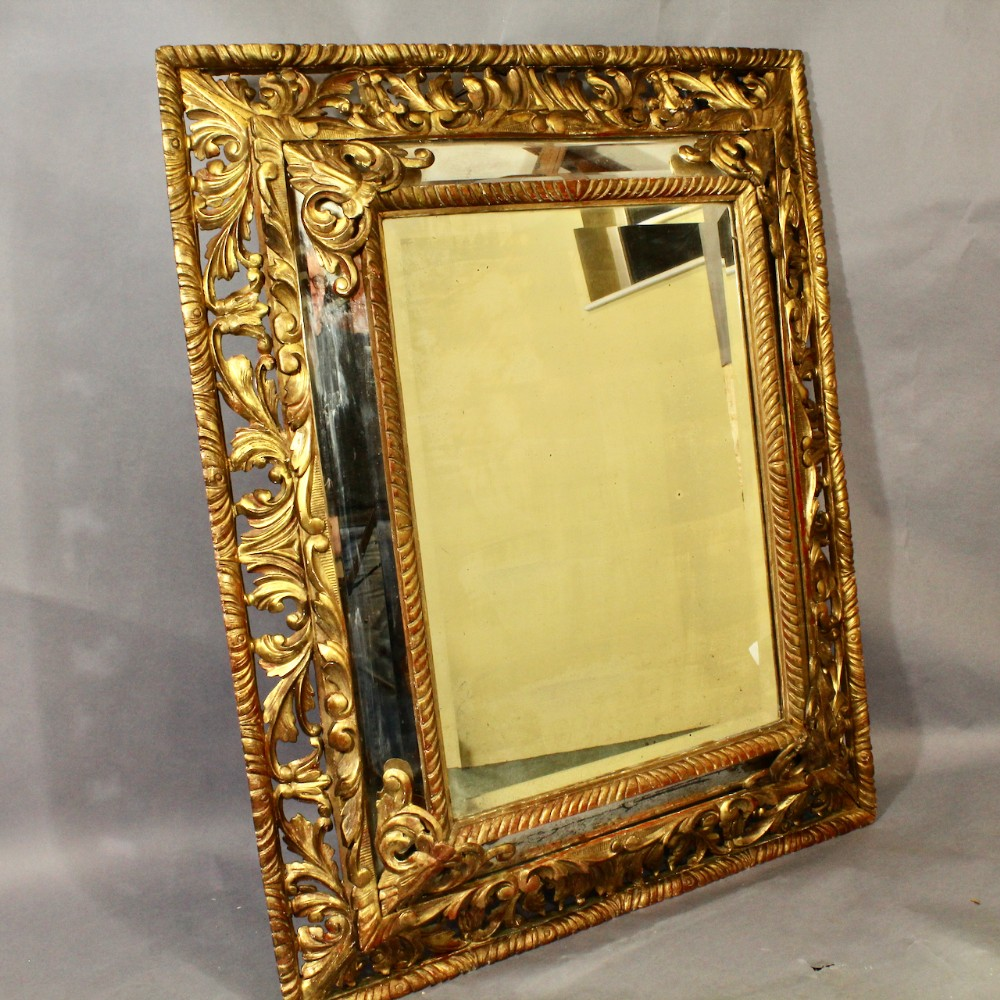 large giltwood cushion mirror
