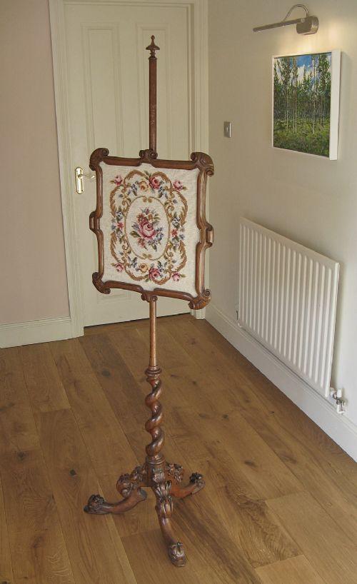 victorian walnut pole screen with needlework panel on spiral shaft tripod base