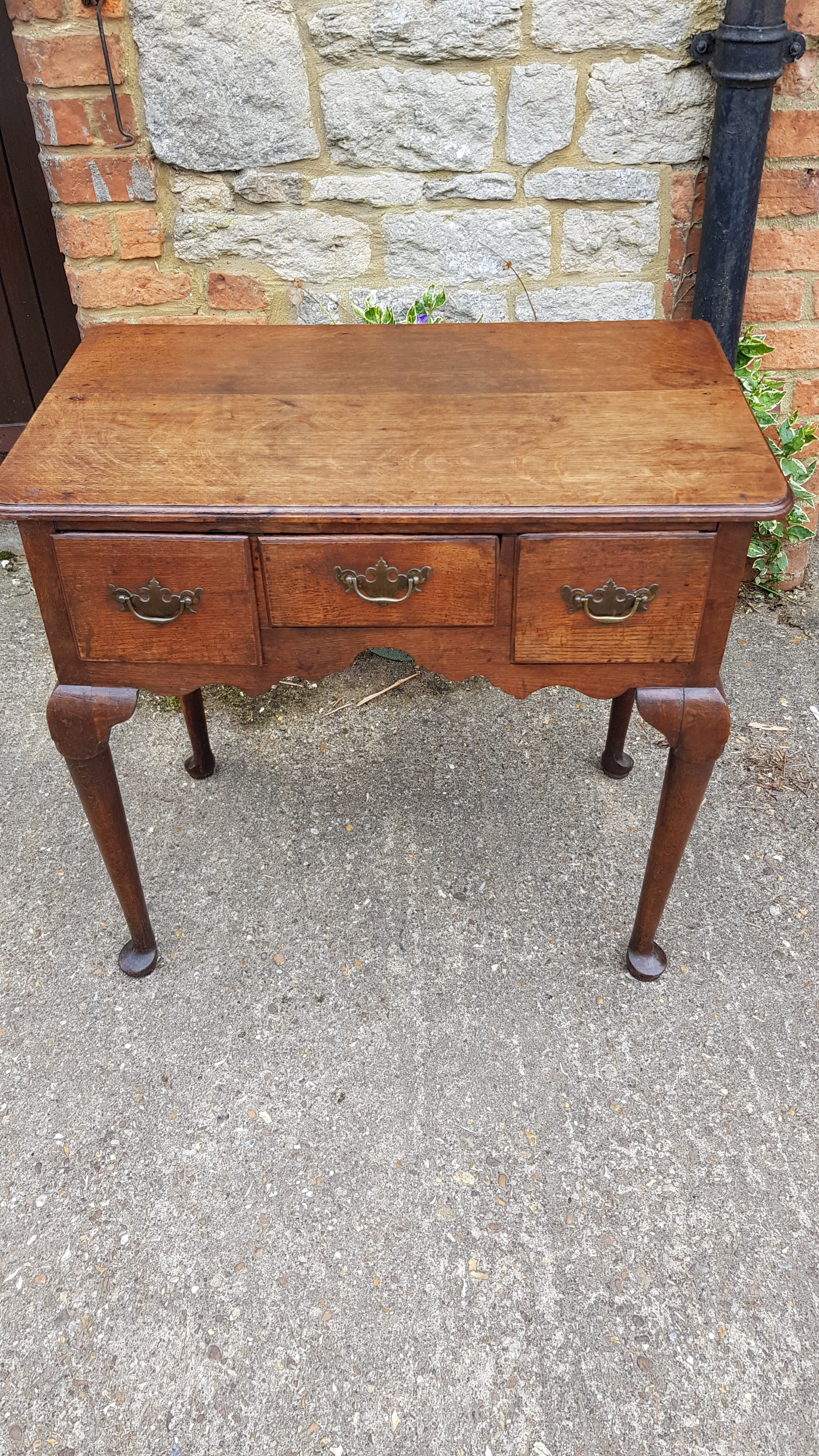 an 18th century oak lowboy