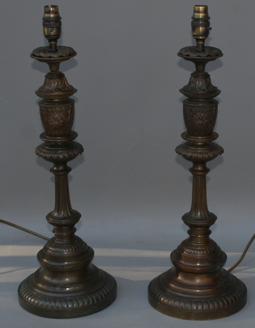a pair of victorian bronze mannerist candlestick table lamps