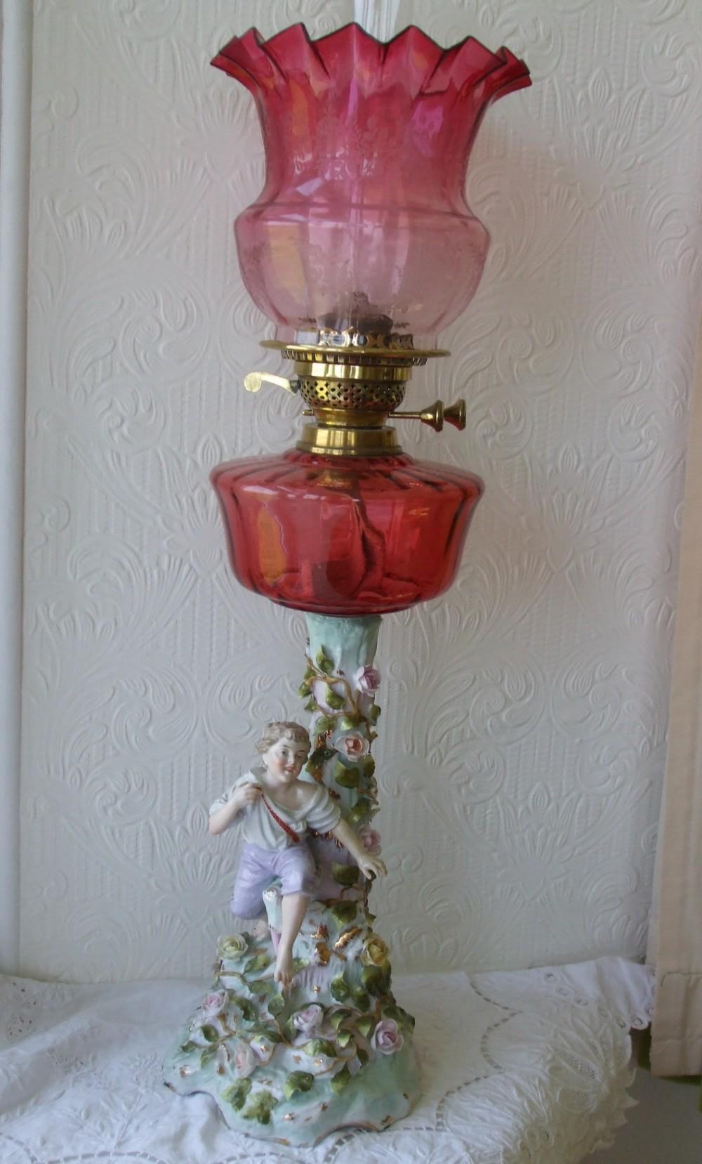 antique german victorian porcelain and cranberry glass oil lamp von schierholz of plaue