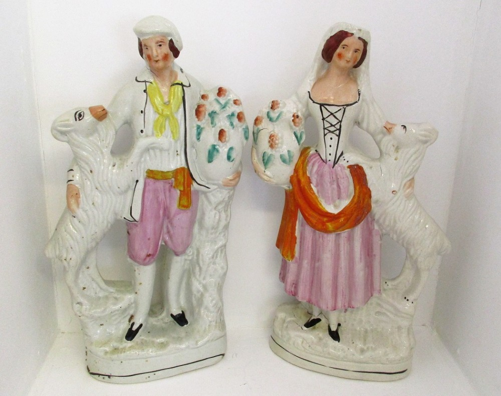 pair of antique english victorian staffordshire pottery figures of goatherds