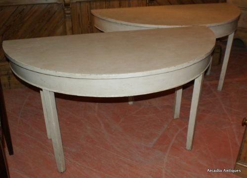 pair of demi lune console tables