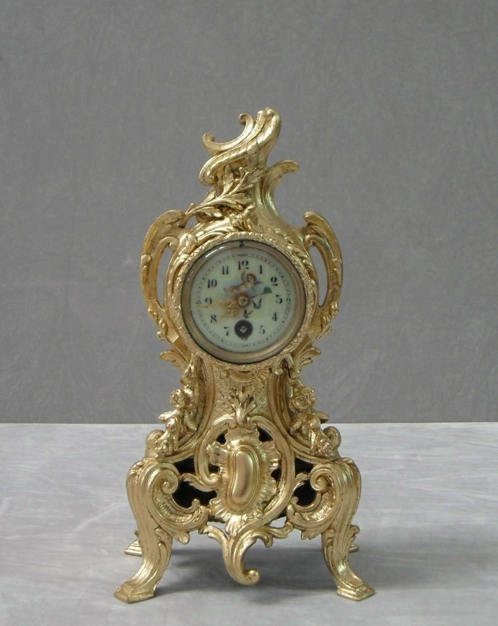 french gilt metal rococo style mantel clock