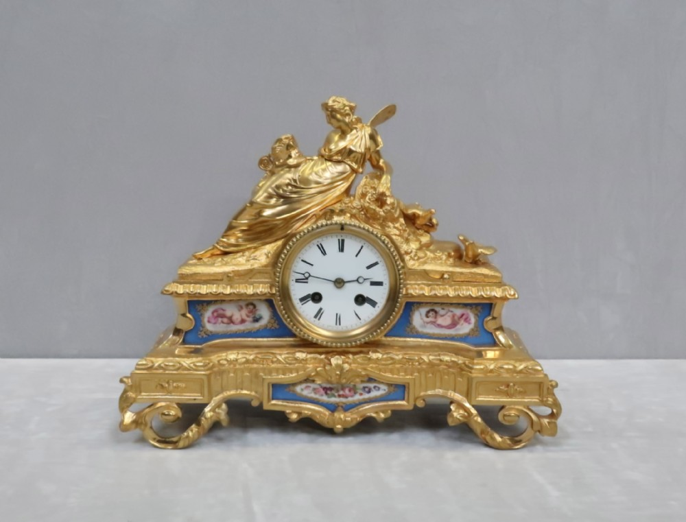 french napoleon iii bronze gilt and porcelain mantel clock by vincenti