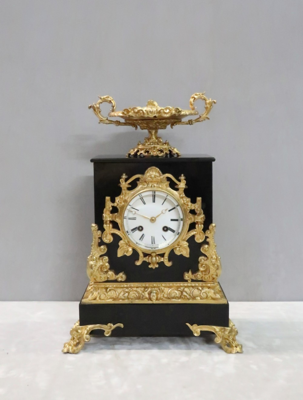 french rococo style black slate and bronze gilt mantel clock