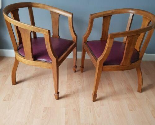 a pair of art deco oak club chairs c1930