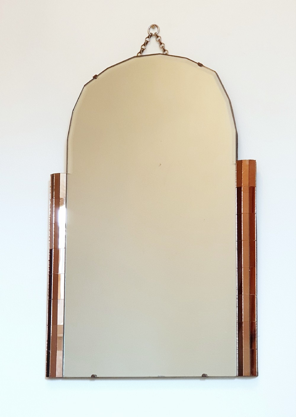 art deco mirror odeon design with amber panel detailing bevelled glass scalloped arch top original hanging chain wooden backing