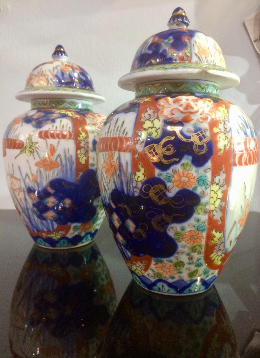 pair of meiji period imari lidded jars