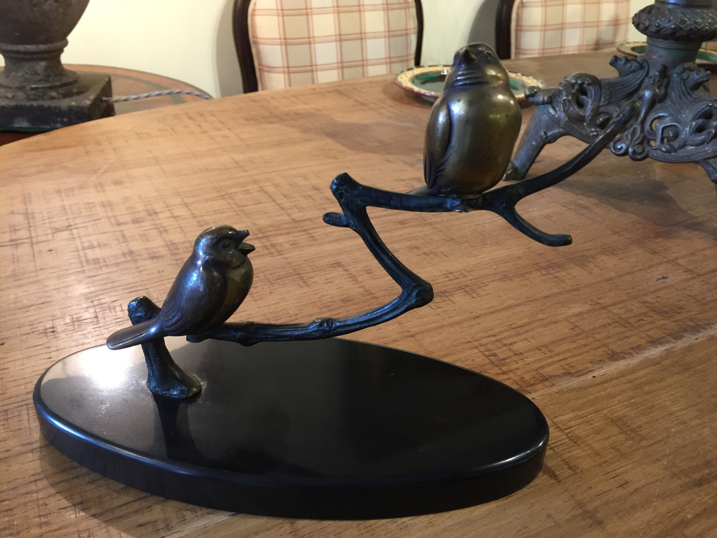 pair of french art deco bronze songbirds resting on a branch c1920
