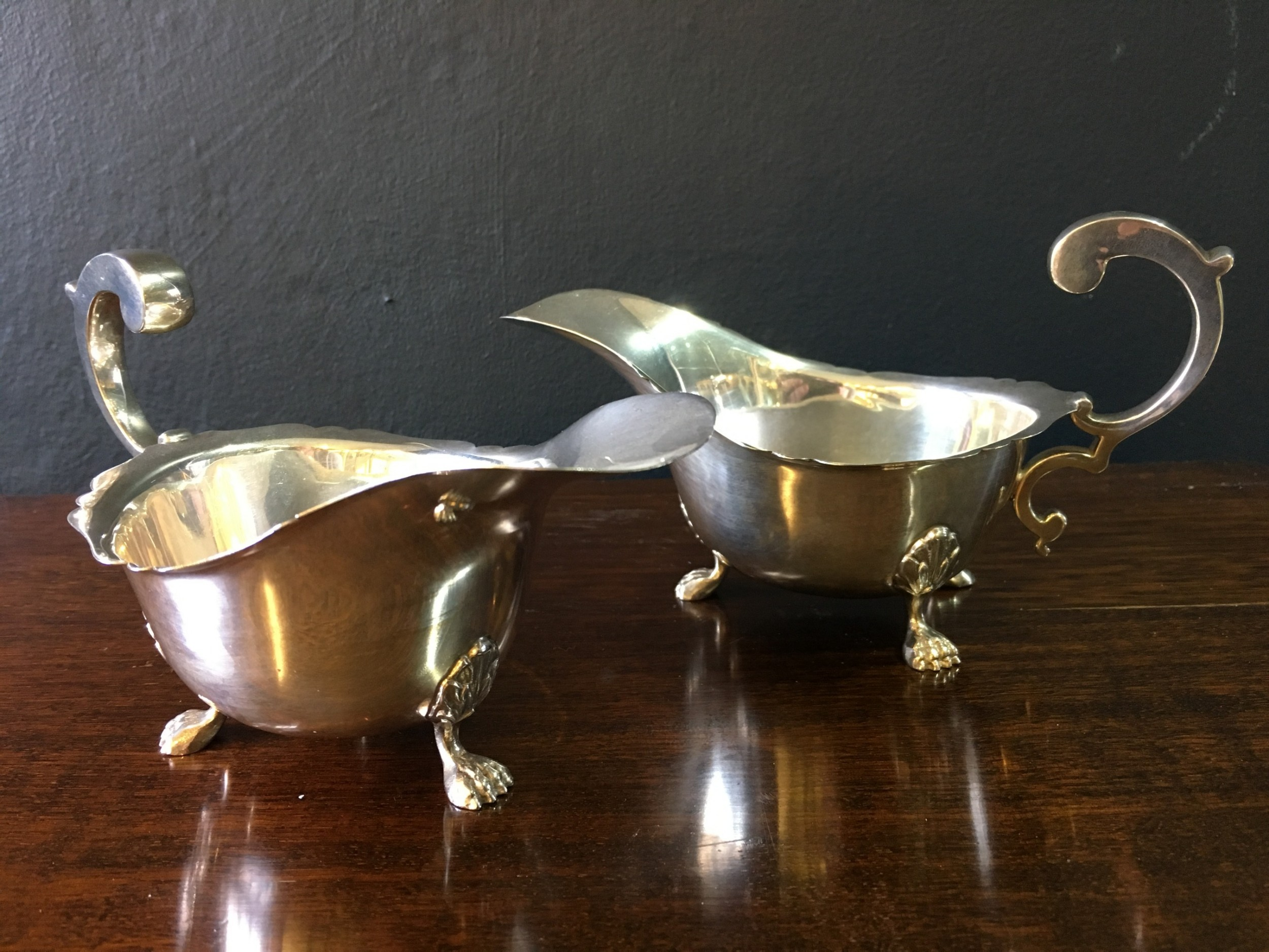 william neale ltd pair of silver sauce boats with with scroll handles acanthusclaw feet birmingham 1913